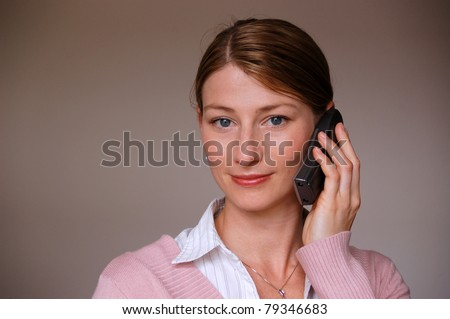 Beautiful business woman on the phone smiling - stock photo