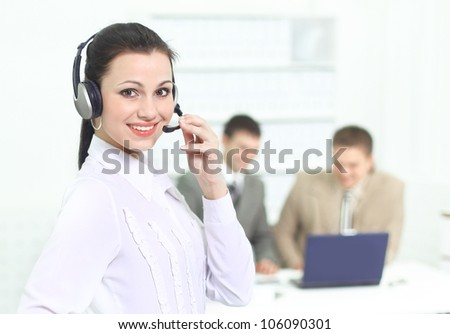 Beautiful business woman operator in the office with his team. - stock photo