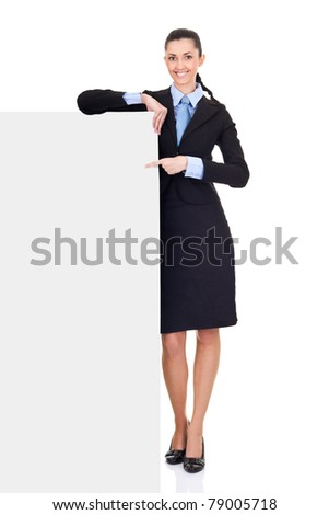 beautiful business woman pointing on big blank paper, isolated on white background, full length, - stock photo