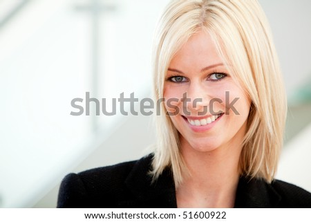 Beautiful business woman portrait at the office smiling