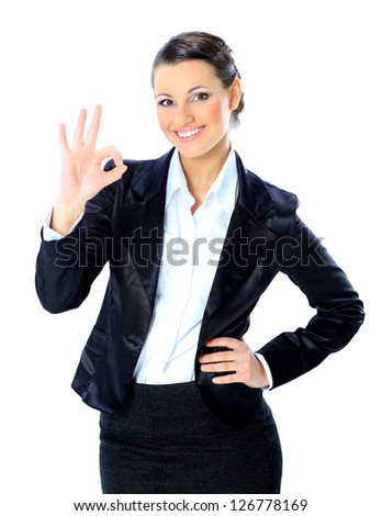 Beautiful business woman show ok. Isolated on a white background. - stock photo