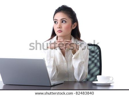 Beautiful business woman sitting in the office and worry about something - stock photo