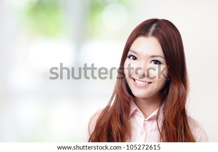 Beautiful Business woman Smile Face close up with green background, model is a asian beauty - stock photo