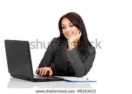 beautiful business woman smile sitting at the desk working using laptop looking at screen  isolated over white background - stock photo