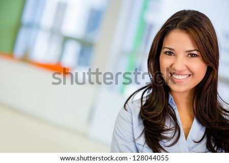 Beautiful business woman smiling at the office - stock photo