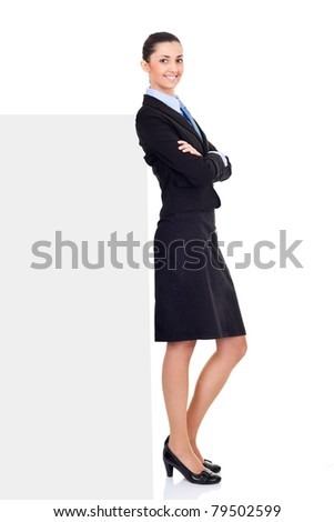 beautiful business woman standing by billboard, isolated on white background,  full length - stock photo