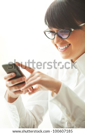 Beautiful business woman talking by phone at office. - stock photo