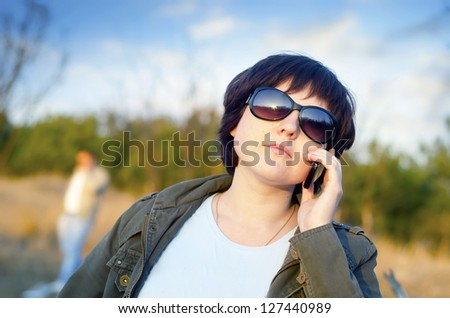 Beautiful business woman talking on cell phone - stock photo