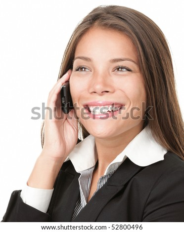 Beautiful business woman talking on cell phone while looking to side. Isolated on white background. - stock photo