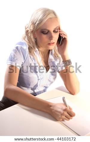 Beautiful business woman talking on telephone - stock photo