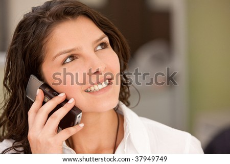 BEautiful business woman talking on the phone - stock photo