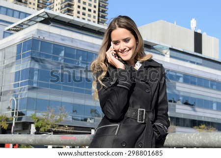 Beautiful business woman talking on the phone during her coffee break.  - stock photo