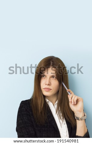Beautiful business woman thinking seriously, copy space above - stock photo