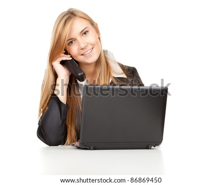 beautiful business woman using her mobile phone and laptop