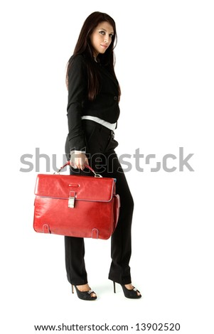 Beautiful business woman walking with red suite case, isolated on a white background - stock photo