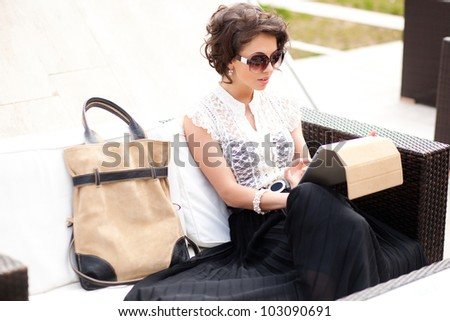 beautiful business woman with a tablet - stock photo