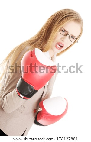 Beautiful business woman with boxing gloves. Isolated on white. - stock photo