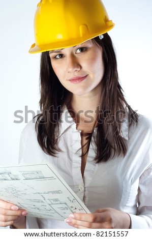 Beautiful business woman with construction plans - stock photo