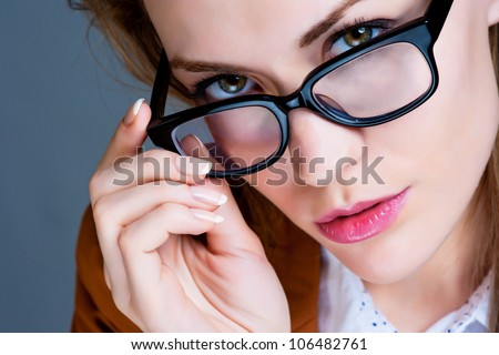 Beautiful business woman with glasses. Close-up portrait - stock photo