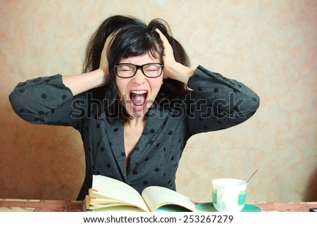 beautiful business woman with glasses hold her head in terror because of business collaps - stock photo