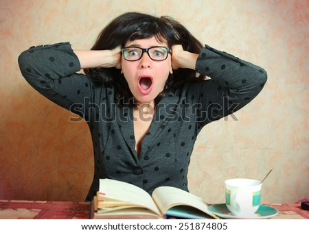 beautiful business woman with glasses hold her head in terror because of business collapse - stock photo