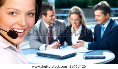 Beautiful  business woman with headset. Business people meeting - stock photo