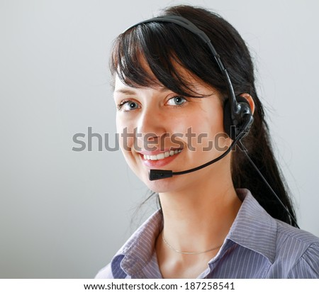 Beautiful business woman with headset. Call center - stock photo