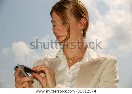 Beautiful Business Woman with Mobile Phone - stock photo