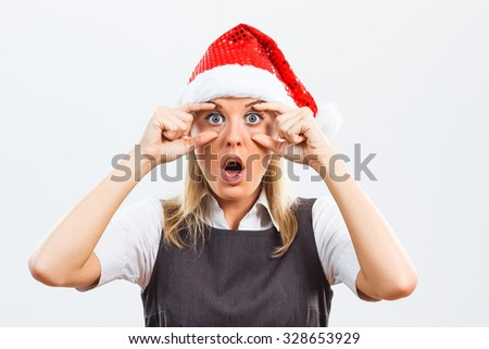 Beautiful business woman with Santa Hat is trying to keep her eyes open in business world and she will continue the same in the New Year.Keep your eyes open in the New Year!
