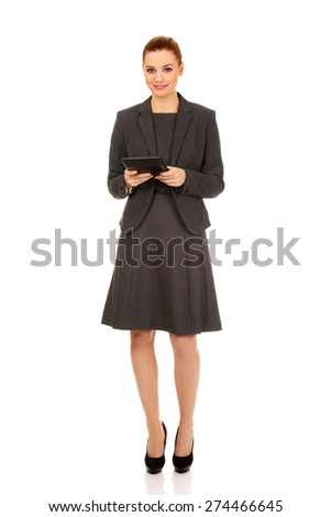 Beautiful business woman with tablet. - stock photo