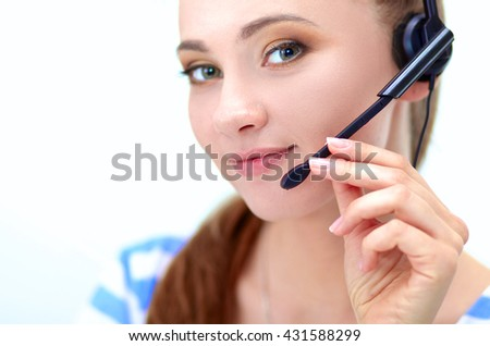 Beautiful business woman working at her desk with headset and laptop - stock photo