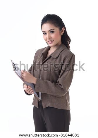 Beautiful business woman working on paper - stock photo
