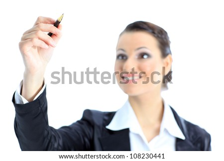 Beautiful business woman wrote pen in the air. Isolated on a white background.
