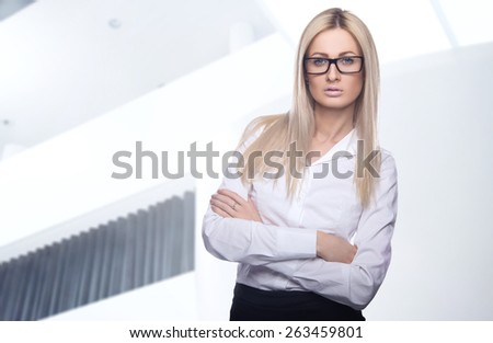 Beautiful business women meet business partners. Business decisions. Office workers. Friendly smiling girl. Beautiful light background - stock photo