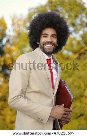 Beautiful Businessman with an afro outside