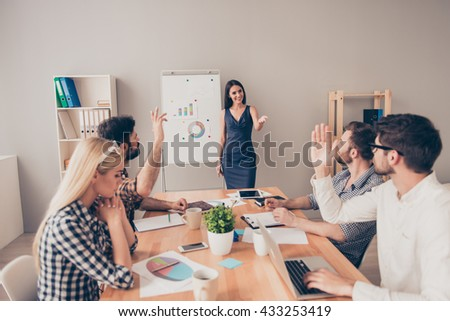 beautiful  businesswoman answers the questions  at the conference  near  flipchart - stock photo