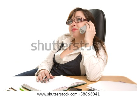 Beautiful businesswoman calling by phone at office