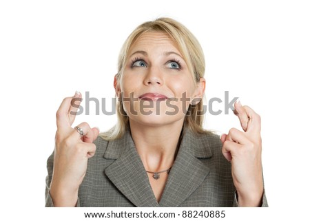 Beautiful businesswoman crossing fingers isolated on a white background