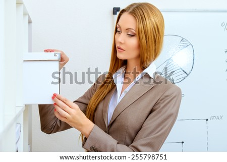 Beautiful businesswoman during the working day in the office. Training, conference. - stock photo