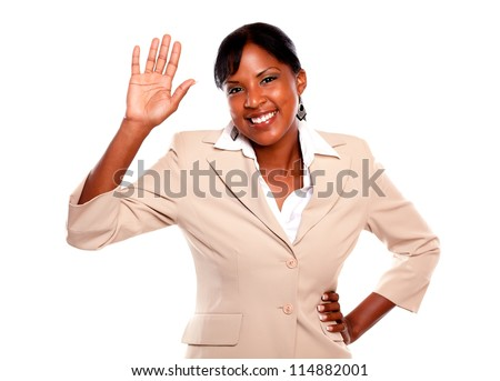 Beautiful businesswoman greeting at you against white background - stock photo