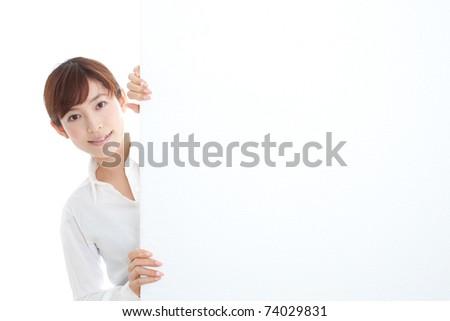 Beautiful businesswoman holding a blank presentation board - stock photo