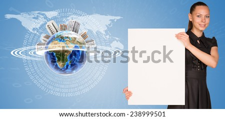 Beautiful businesswoman holding blank paper sheet. Beside is miniature Earth with houses on it and surrounded by rings, part of them composed of digits. Elements of this image furnished by NASA - stock photo