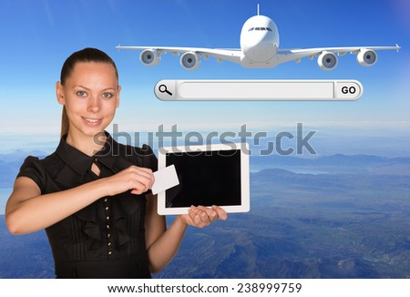 Beautiful businesswoman holding blank tablet PC and blank business card in front of PC screen.Beside are jet airplane and search bar with Go button - stock photo