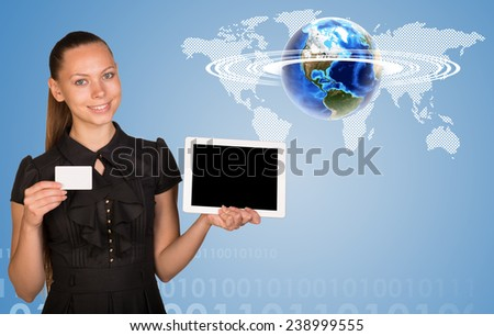 Beautiful businesswoman holding blank tablet PC and blank business card. World map, figures and globe surrounded by horisontal rings as backdrop. Elements of this image furnished by NASA - stock photo
