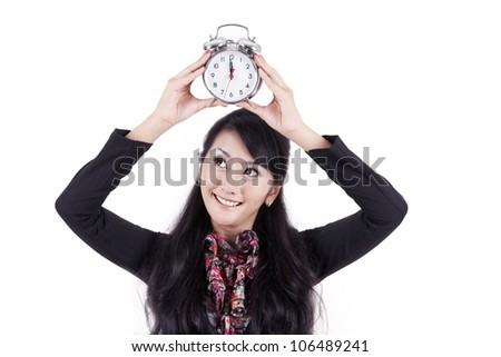 Beautiful businesswoman holding up an alarm clock that says it is break time - stock photo