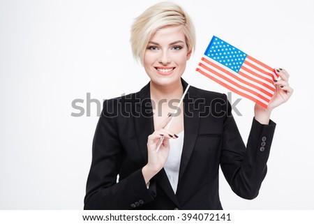 Beautiful businesswoman holding USA flag isolated on a white background - stock photo
