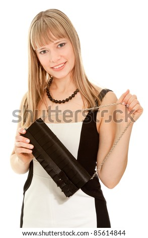 Beautiful businesswoman in dress and clutch smiling and looking to the camera - stock photo