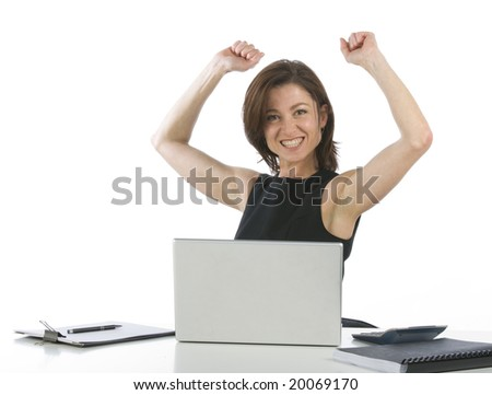 Beautiful businesswoman in her office exulting - stock photo