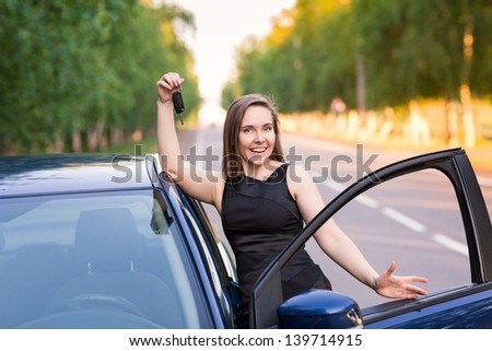 Beautiful businesswoman near her car on the road