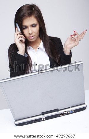 Beautiful Businesswoman on Phone - stock photo